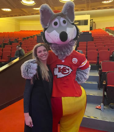 Angela Murphy posing for a picture with the Kansas City Chiefs mascot
