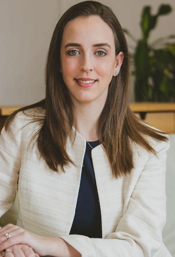Professional headshot photo of Suzanne Huber, facing forward