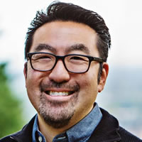 Headshot photo of Gene Kim