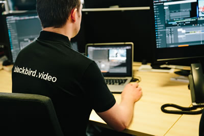 man editing video with blackbird software