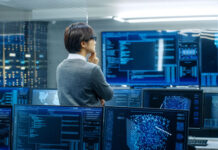 young man monitoring systems in data center