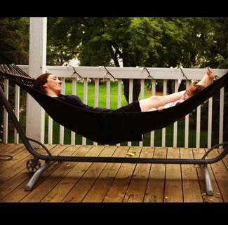 Kellie Stecher rocking in hammock with daughter
