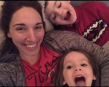 Kellie Stecher taking selfie with her two kids