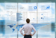 man standing in front of a hologram digital analytical dashboard