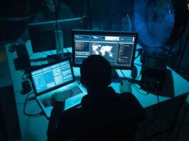 computer hackers in underground dark room
