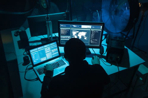 computer hackers in underground dark room
