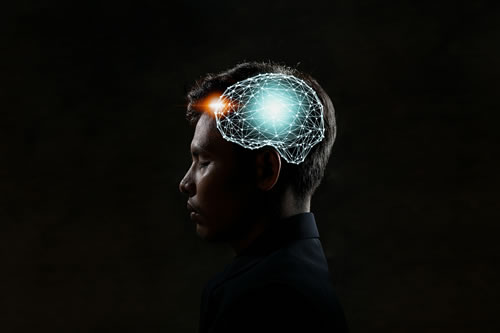 side view of man with a visual digital brain displayed on the side of his head