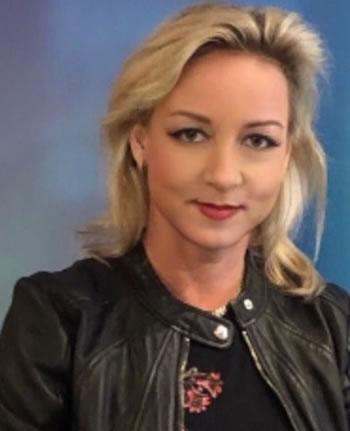 casual dressed headshot of Ingrid Vasiliu-Feltes