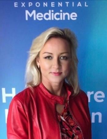 casual dressed headshot of Ingrid Vasiliu-Feltes in red jacket