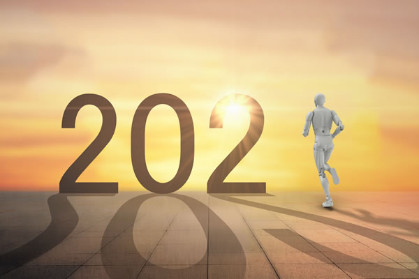 year 2021 with robot running towards sunset horizon