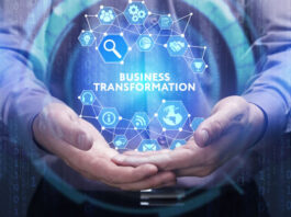 man clasping hands together and holding a hologram globe that shows business transformation