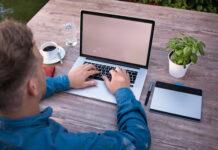 software developer working remote on laptop outside
