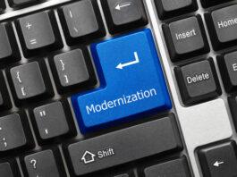 PC keyboard with blue enter key with modernization word