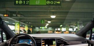 inside of autonomous car looking at dashboard and windshield