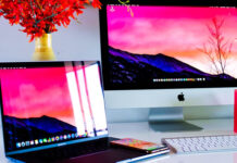 two apple macs sitting on a desk