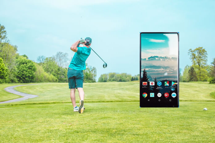 golfer swing on a golf course with a smart phone showing a smart app