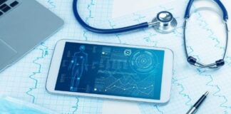 smart phone with health radiology app showing next to ekg and stethascope