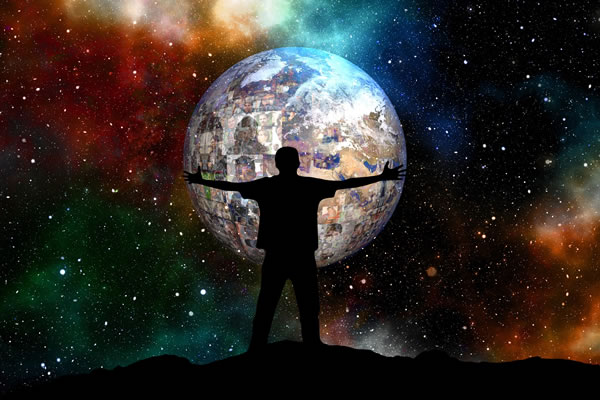 silhouette of man holding digital world with starry solar system in background