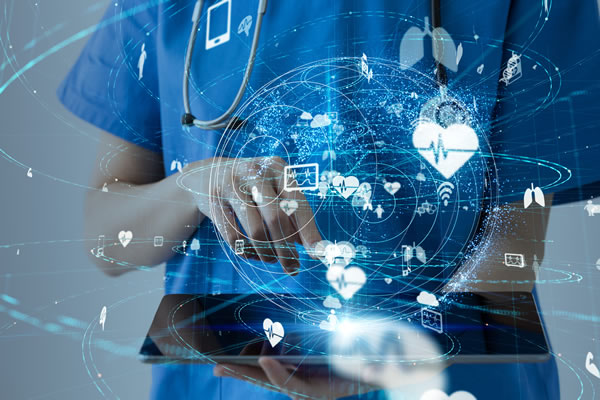 healthcare provider holding tablet with digital IoT images floating above the tablet