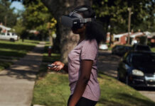 teenage girl outside using virtual reality headset