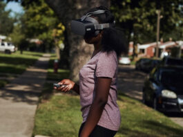 teenage girl outside using virtual reality headset