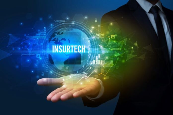 man in suit holding a virtual sphere with the words insurtech on it