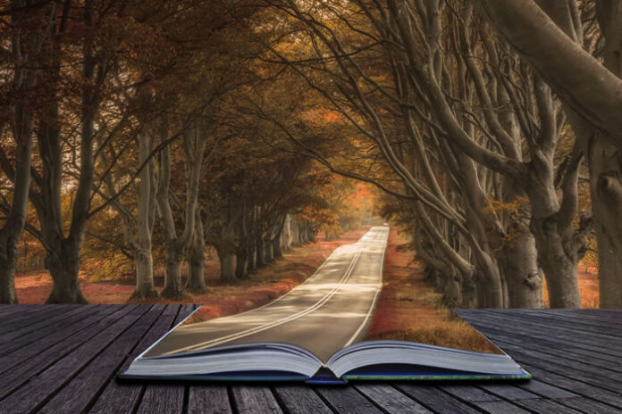 book opened up with a story that merges into a winding road, like a metaphor