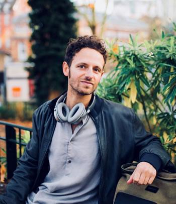 Headshot of Bruno Zamborlin on park bench