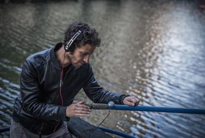 Bruno Zamborlin using vibration device to make music with oar