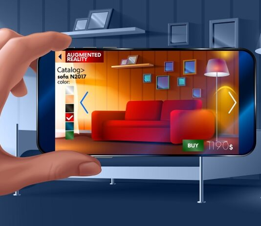 hand holding up mobile phone over picture of furniture while browsing online store