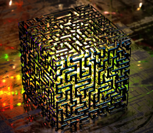 a cube with a maze design that is lit up from the inside representing a quantum cube