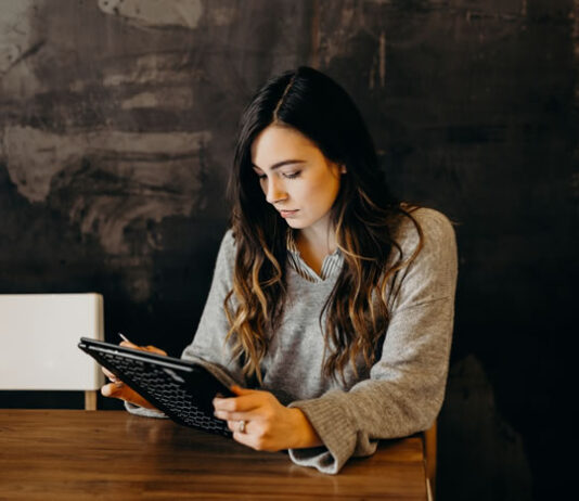 woman on tablet building trust with email marketing
