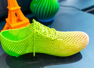 3D printed objects including a shoe, vase, and Eiffel Tower