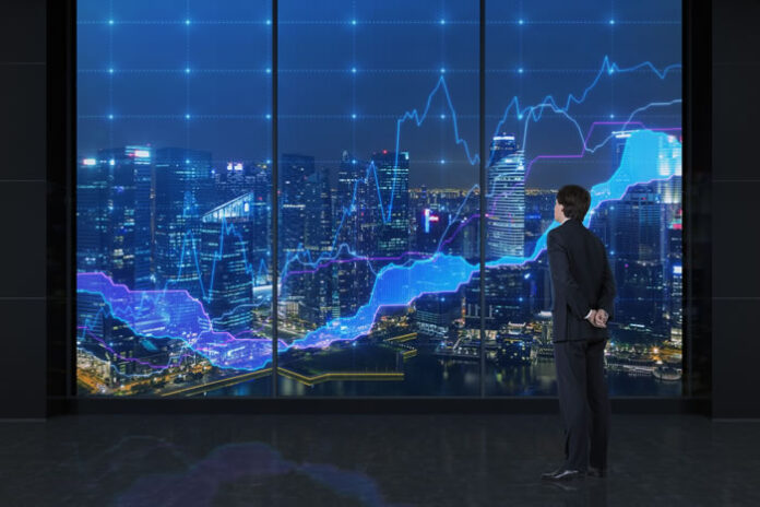 businessman standing in front of visual screen displaying city with predictive analytics