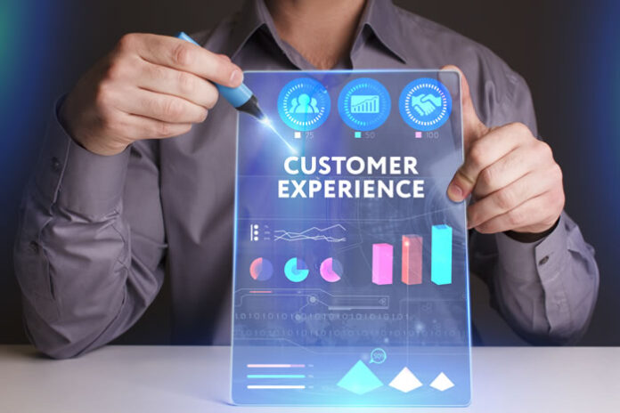 young man holding up a digital and virtual dashboard with the words customer experience