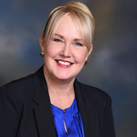 Headshot of Chief Growth Officer Pamela Gould