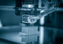 3D printer in action printing a piece of space material