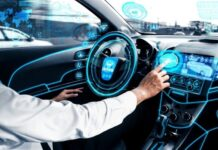 man in autonomous vehicle and pressing a button on a digital screen