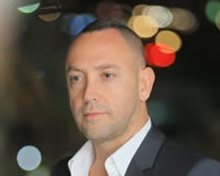 Headshot of CEO Meyr Aviv