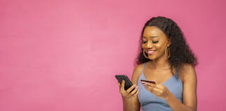 smiling woman using her mobile phone for ecommerce online