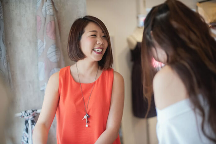 two Indonesian business women smiling and chatting