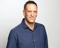 Headshot of CEO Chemi Katz