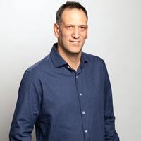 Headshot of CEO Chemi Katz