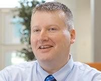 Headshot of President Mark Mortimer