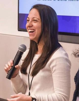 CEO Rachel Serwetz speaking on microphone