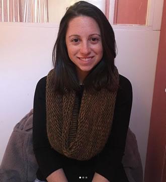 CEO Rachel Serwetz sitting smiling facing camera