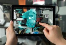 person interacting with a tablet using AR to better explain
