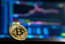 bitcoin cryptocurrency coin floating in front of an analytical trading dashboard