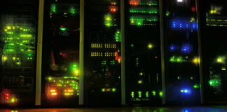 darkened data center showing server infrastructure with many led lights