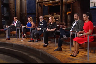 Canada's Dragon's Den Cast all sitting on stage